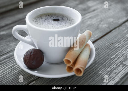 Cup of coffee with cookies on wooden table. Coffee break, breakfast. Selective focus - Stock Photo