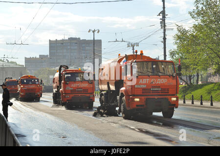 Street sweeper vehicles cleaning Moscow's streets. - Stock Photo