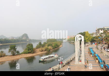 People take cruise boat on Li River in Guilin China. - Stock Photo