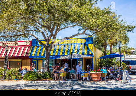 People dining at outdoor sidewalk cafe on Main Street in Sarasota Florida - Stock Photo