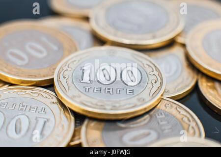 Many hundreds of tenge of coins. Kazakhstan money, close-up. - Stock Photo