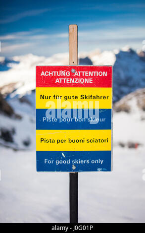 Waring sign saying For good skiers only, Engelberg Switzerland - Stock Photo