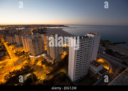 Hotels and beach at the bank of the ocean during sunrise. Vew from above. Pria Da Rocha, Portimao, Portugal. - Stock Photo