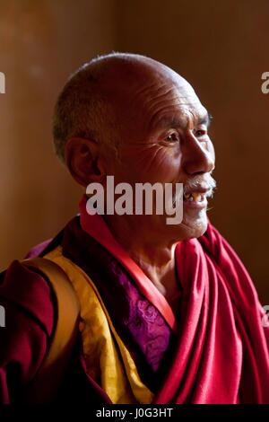 Monk, Gangtey Dzong or monastery, Phobjikha Valley, Bhutan - Stock Photo