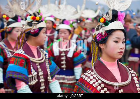 Black Miao girls dancing at festival, Kaili, Guizhou Province, China - Stock Photo