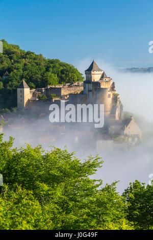 Morning mist, Chateau de Castelnaud, Castelnaud, Dordogne, Aquitaine, France - Stock Photo