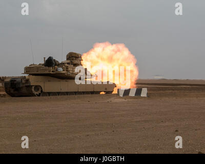 A 3rd Armored Brigade Combat Team, 1st Cavalry Division M1A2 Abrams Main Battle Tank engages targets during the - Stock Photo