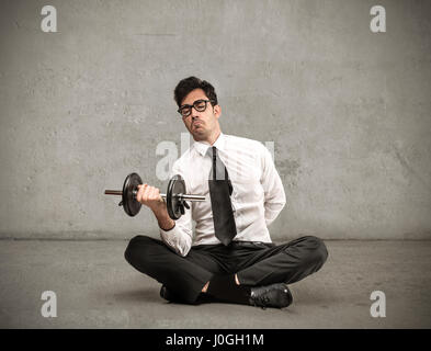 Businessman weightlifting - Stock Photo