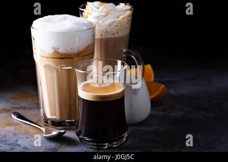 Coffee latte, black espresso and viennese coffee - Stock Photo