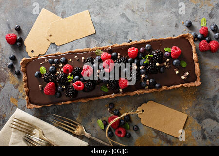 Chocolate ganache tart with fresh berries - Stock Photo