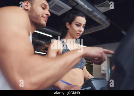 Personal trainer guiding sports woman - Stock Photo