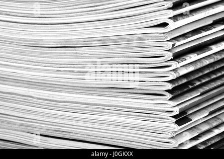 Stack of old colored magazines close-up. B&W - Stock Photo