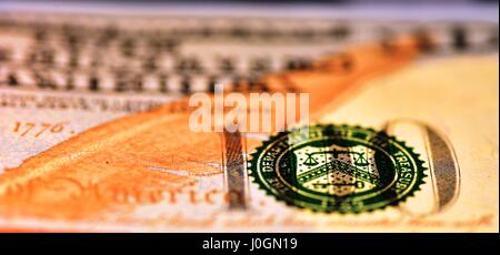 Macro shot on the 100 USD bill with narrow field of view and the balance partially in focus - Stock Photo