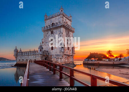 Belem Tower or Tower of St Vincent on the bank of the Tagus River at scenic sunset, Lisbon, Portugal - Stock Photo
