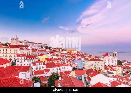 View of Alfama, the oldest district of the Old Town, with Monastery of Sao Vicente de Fora, Church of Saint Stephen - Stock Photo