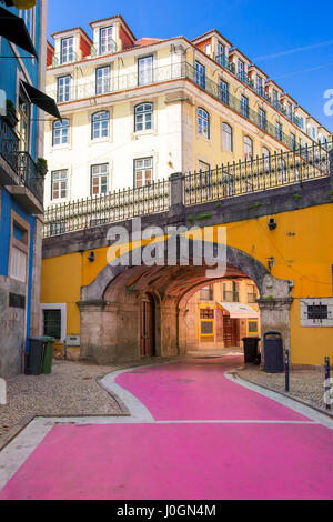 The famous pedestrian Pink street of Rua Nova do Carvalho in the Cais do Sodre area of Lisbon, Portugal - Stock Photo