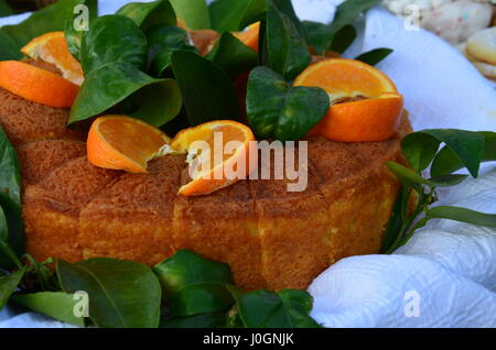Home made whole testy orange cake - Stock Photo