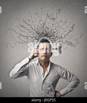 Businessman with a mess in his head - Stock Photo