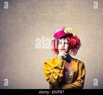Clown woman thinking inside - Stock Photo