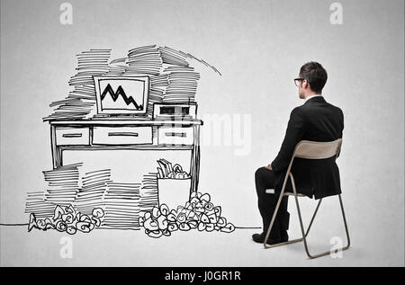 Businessman in front of drawn desk - Stock Photo