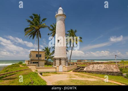 Light house at Galle Dutch Fort 17th centurys ruined dutch castle. That is unesco listed as a world heritage site - Stock Photo