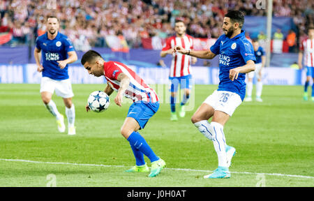 Madrid, Spain. 12th April, 2017. Angel Correa (Forward, Atletico de Madrid) in action covered by Riyad Mahrez (Mildfierder, Leicester City) during the football match of quarterfinals of 2016/2017 UEFA Champions League between Atletico de Madrid and Leicester City  Football Club at Calderon Stadium on April 12, 2017 in Madrid, Spain. ©David Gato/Alamy Live News