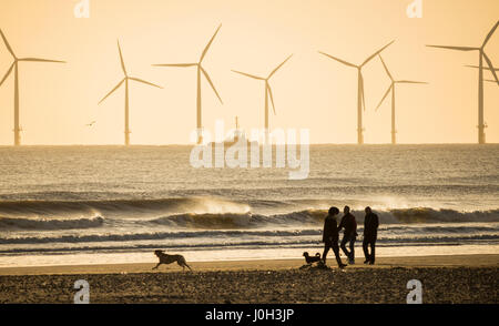 Seaton Carew, County Durham, north east  England. United Kingdom. 13th April, 2017. Weather: Dog walkers at sunrise - Stock Photo
