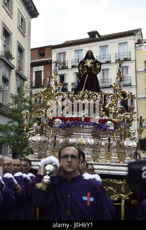 Madrid, Spain. 13th Apr, 2017. Hooded penitents from ' Jesus Nazareno el pobre y Maria Santisima del dulce nombre' - Stock Photo