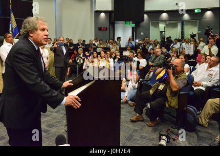 Doral, Estados Unidos. 13th Apr, 2017. Secretary General of the OAS, Luis Almagro (L), speaks during the event of - Stock Photo