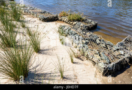 Riprap stone filled Gabion cages for river bank environmental stabalisation along the Perth foreshore, Western Australia - Stock Photo