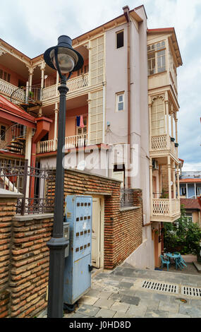 Tbilisi, Georgia - September 24, 2016: View of narrow street in Old city - Stock Photo