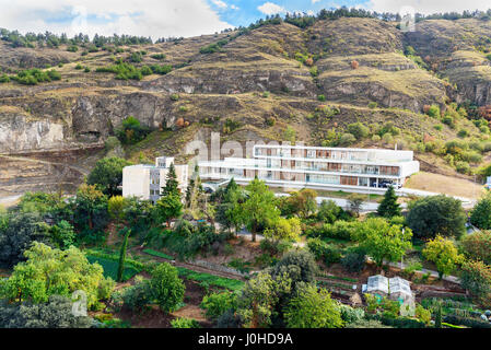 Tbilisi, Georgia - September 24, 2016: View of Modern white building in the mountains - Stock Photo