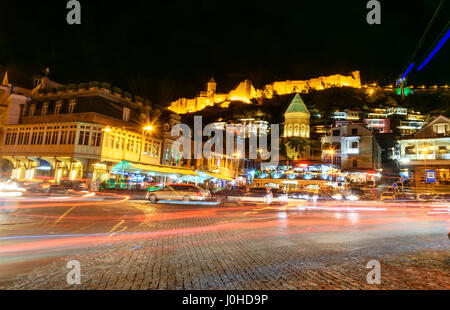 Tbilisi, Georgia - September 24, 2016: Viev of Old city with shops, restaurants and cafes at night - Stock Photo