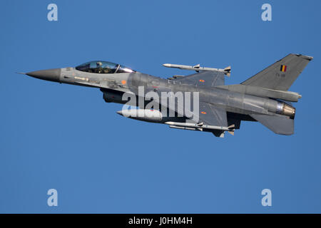 LEEUWARDEN, THE NETHERLANDS - MRT 28, 2017: Belgian Air Force F-16 fighter jet plane taking off during NATO exercise - Stock Photo
