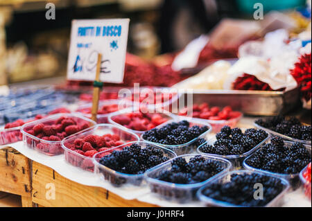 Boxes of Fresh Raspberries and Blackberries on Sale at Rialto Food Market in Venice, Italy - Stock Photo