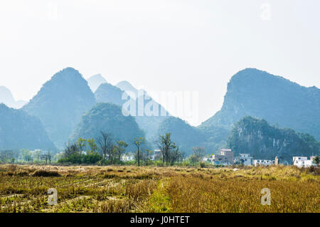 Karst mountains and rural scenery in winter, Guilin, China. - Stock Photo