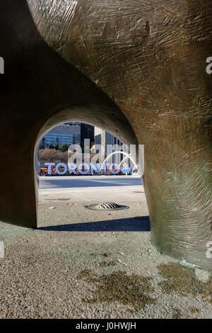 Toronto City Hall, Nathan Phillips Square, horizontally inverted image of Toronto sign viewed from The Archer by - Stock Photo