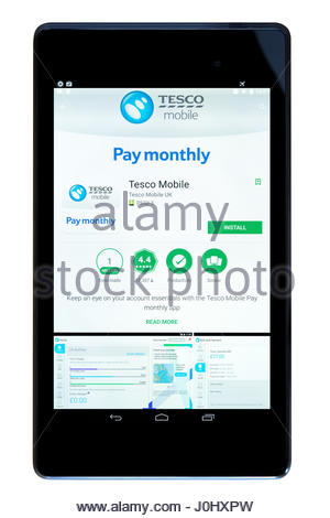 Tesco pay monthly app on an android tablet PC Dorset England UK - Stock Photo