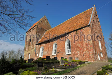 Kirchturm Suurhusen, the leaning church tower located at Hinte in East Friesland, Lower Saxony, Germany. - Stock Photo