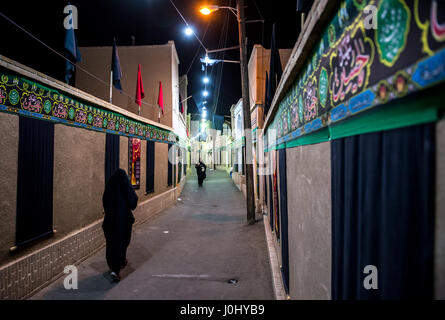 Muharram decorations on narrow street of the Old Town in Kashan city, capital of Kashan County of Iran - Stock Photo