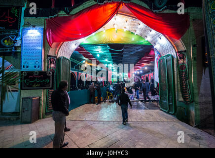 People in front of mosque decorated for Muharram month in Kashan city, capital of Kashan County of Iran - Stock Photo