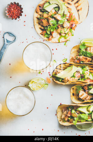 Healthy corn tortillas with chicken, vegetables and beer in glasses - Stock Photo