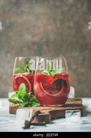 Blood orange and strawberry summer Sangria in glasses, copy space - Stock Photo