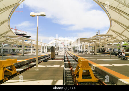 Denver, USA - May 25, 2016: The open air train hall at the Union Station with buffers at the end of the tracks and - Stock Photo