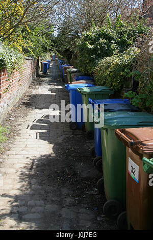 Wheeled recycling bins in back alley awaiting collection in Heaton Mersey near Stockport - Stock Photo