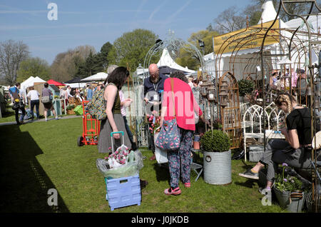 Women looking at garden metal supports and frames for climbing plants at a stall at the RHS Flower Show in Bute - Stock Photo