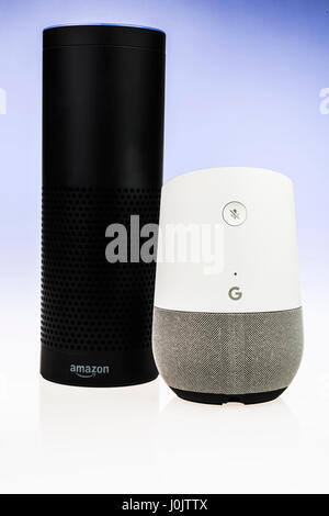 Google Home and Amazon Echo smart speakers.  Both offer voice activated personal assistants, music playing and home automation control. (blue background)