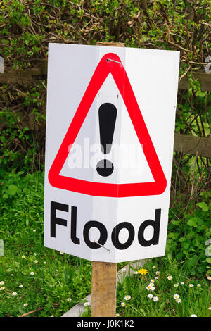 Temporary flood warning traffic sign posted on a rural British road advising drivers of flooding ahead - Stock Photo