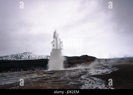 Strokkur, Iceland's famous natural geyser located in the Golden Circle, shoots up out of the rock. - Stock Photo