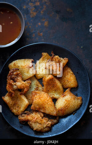 Fried calamari with sweet chilli dip - Stock Photo